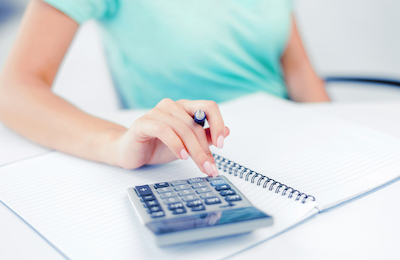 Woman at her desk doing accounting